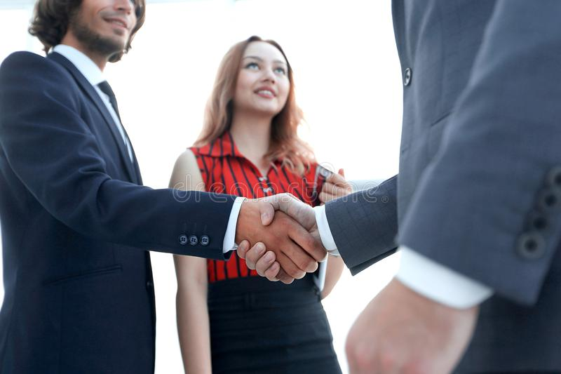 Businessmen handshaking after good deal. Business concept. Successful business people handshaking after good deal stock photos