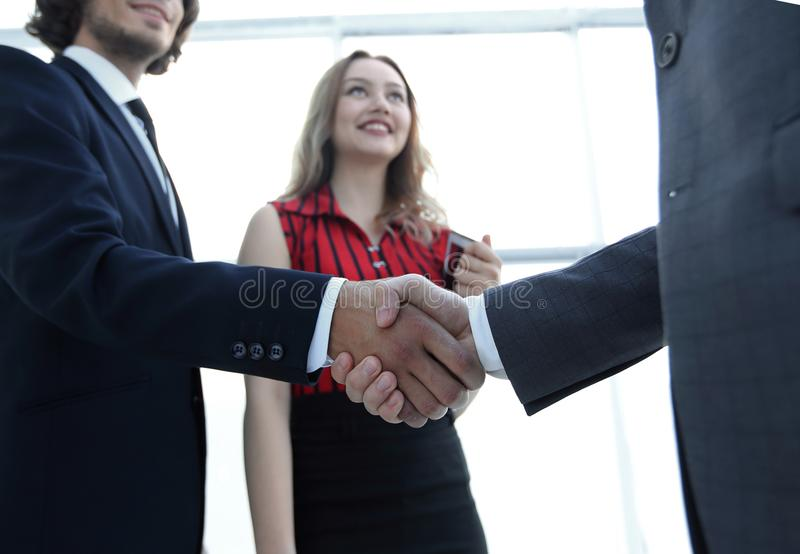 Businessmen handshaking after good deal. Business concept. Successful business people handshaking after good deal royalty free stock image