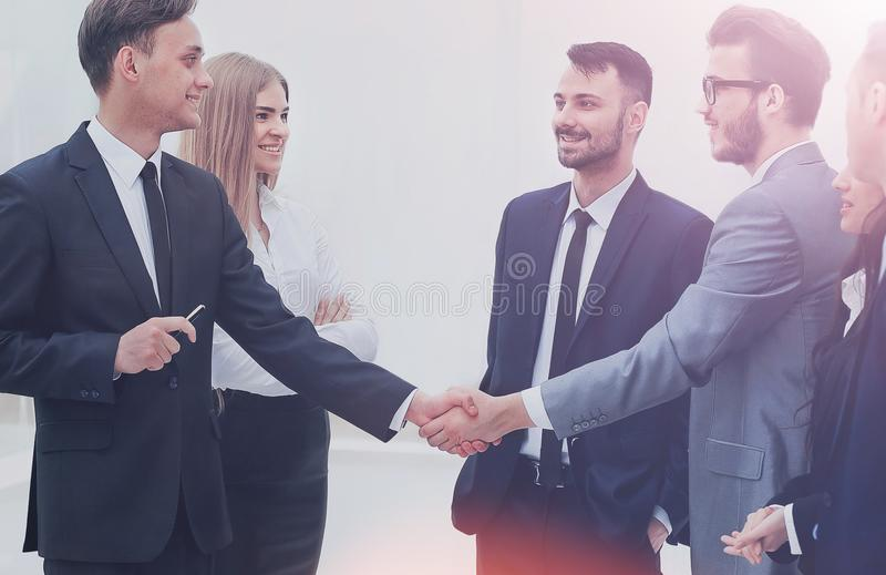 Businessmen handshaking after presentation royalty free stock photos
