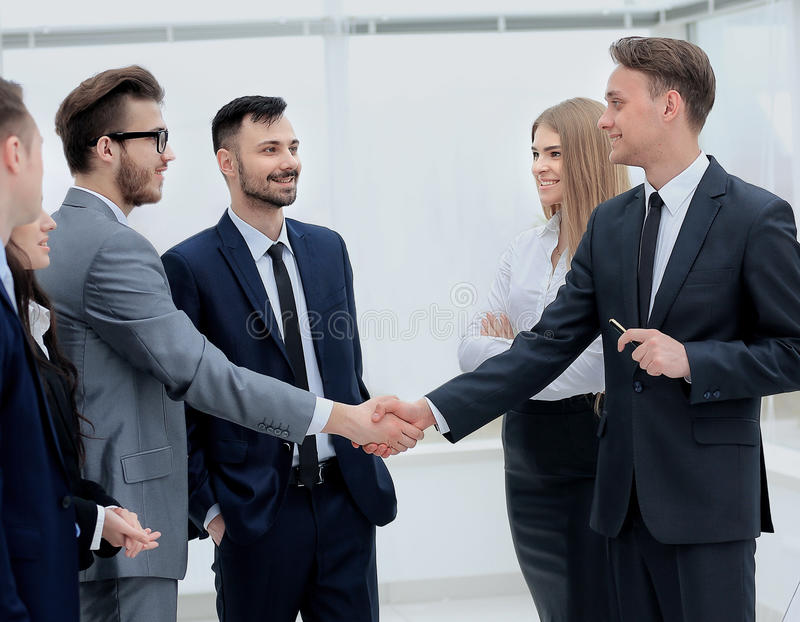 Businessmen handshaking after presentation stock photos