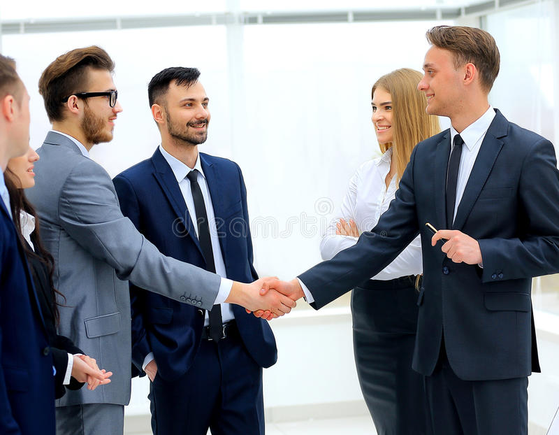 Businessmen handshaking after presentation royalty free stock images