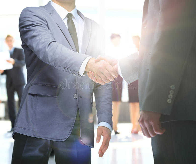 Businessmen handshaking after striking deal royalty free stock image