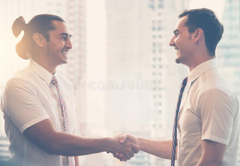 Businessmen handshaking after success business negotiation stock photos