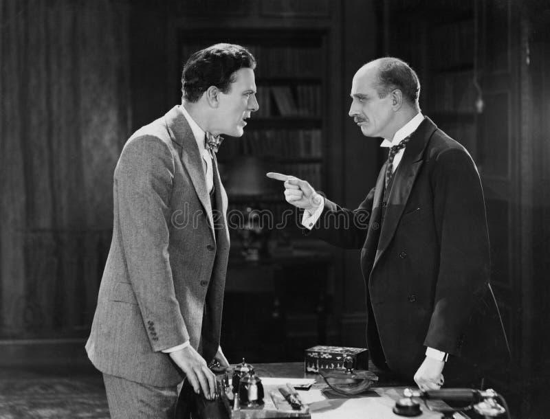 Businessmen having argument stock image