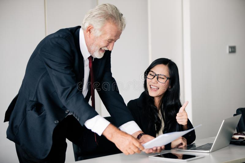 Businessmen holding documents for business partners discussing  and share ideas at meeting and business women smiling happy for royalty free stock images