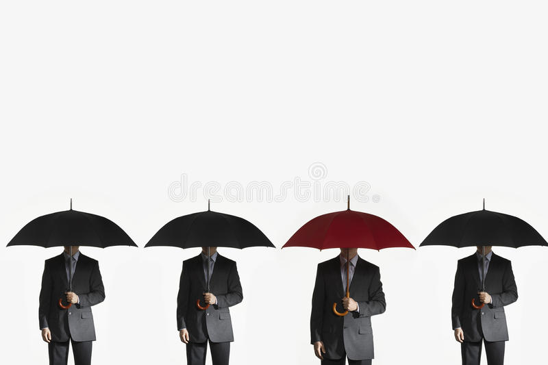 Businessmen Holding Umbrellas In Row royalty free stock photo