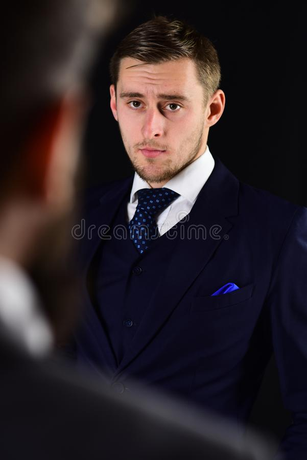 Businessmen look at each other with judgment. Eye contact concept. Businessmen, business partners meeting on black royalty free stock images