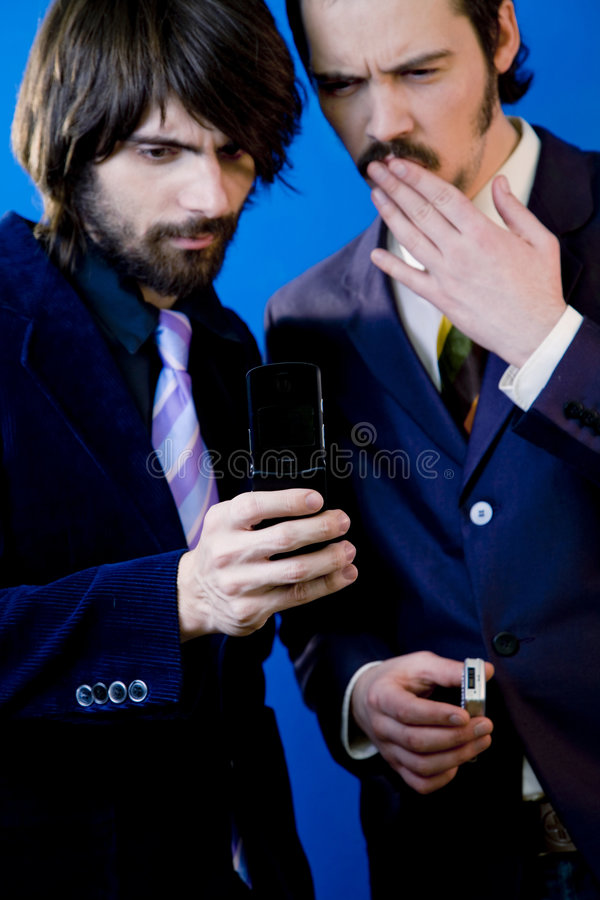 businessmen looking at phone stock images