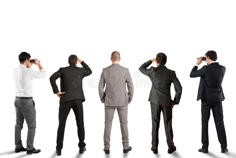 Businessmen looking to the future. Businessmen carefully look in the same direction stock photo