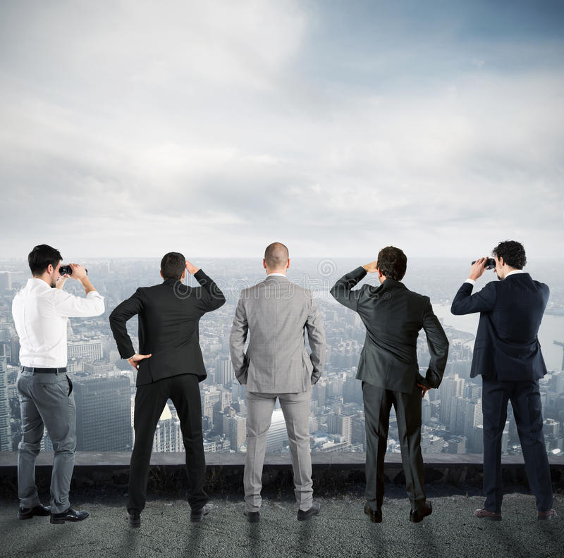 Businessmen looking to the future stock photo