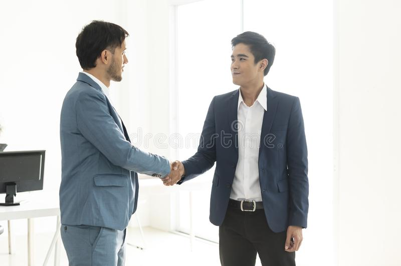 Businessmen making handshake agreement. concept partner to business.  stock photography