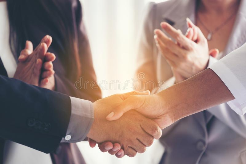 Businessmen making handshake in the city - business etiquette, c. Ongratulation, merger and acquisition concepts, panoramic banner, Vintage tone Retro filter royalty free stock photography