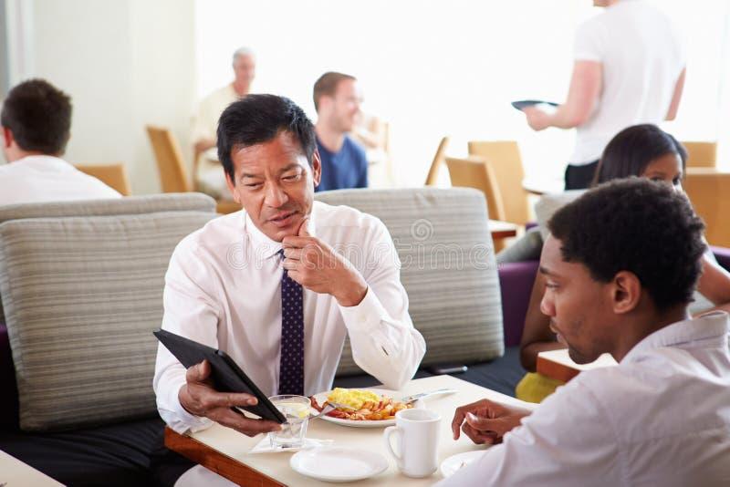 Businessmen Meeting Over Breakfast In Hotel Restaurant stock photo