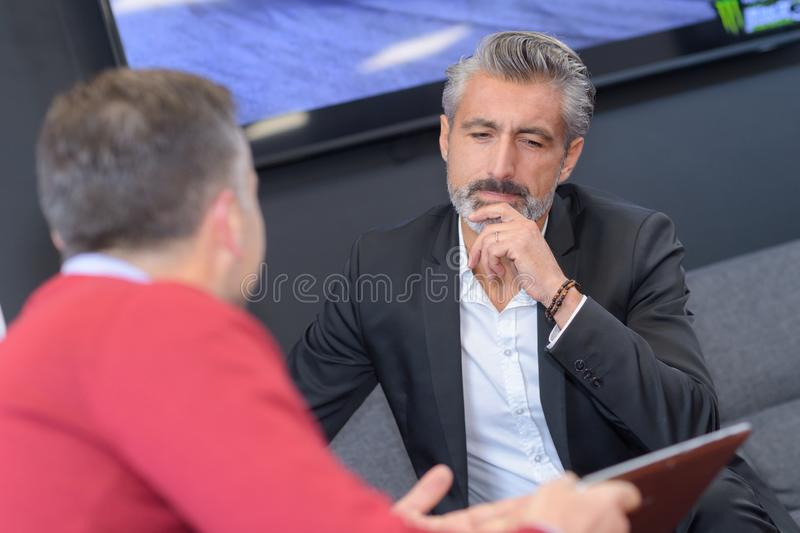 Businessmen meeting up for project royalty free stock image