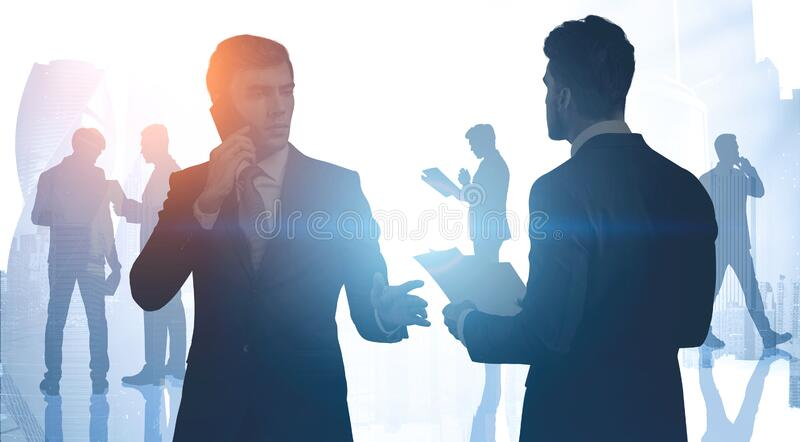 Businessmen in modern city, teamwork. Teamwork and corporate lifestyle concept. Business people working together in abstract city. Toned image double exposure royalty free stock photography