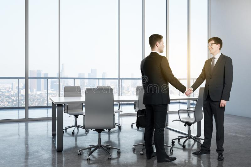 Businessmen in modern meeting room stock photography