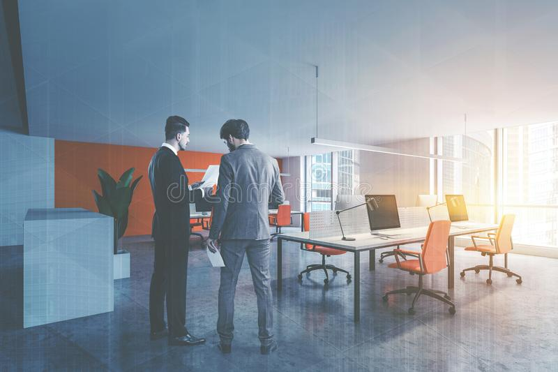 Businessmen in modern open space office corner royalty free stock photos