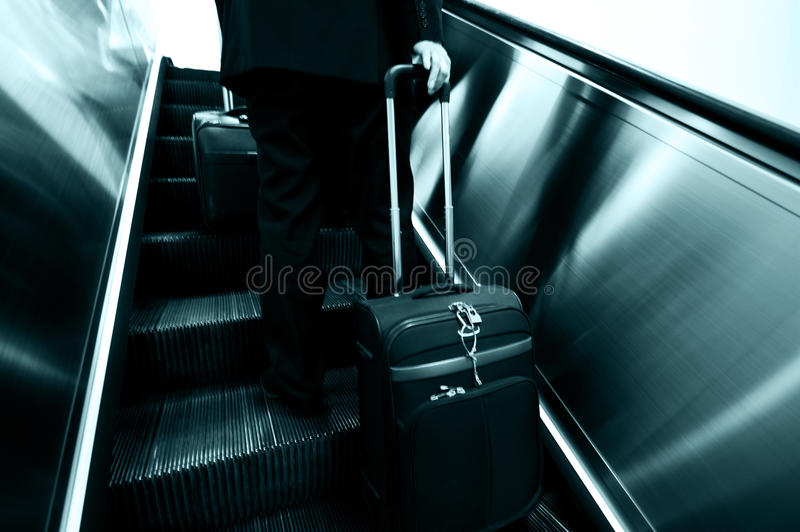 Businessmen on moving staircase stock photo