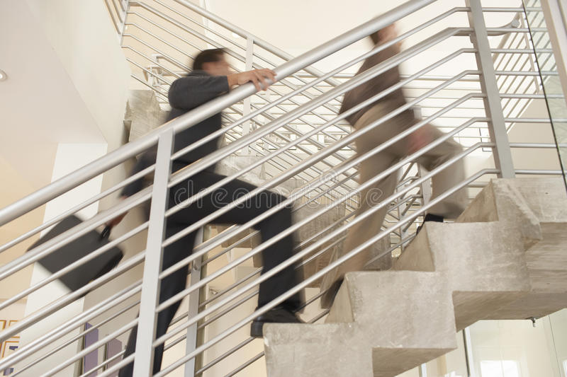 Businessmen Moving Upstairs In Office royalty free stock image