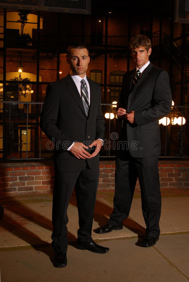 Businessmen at night royalty free stock photos