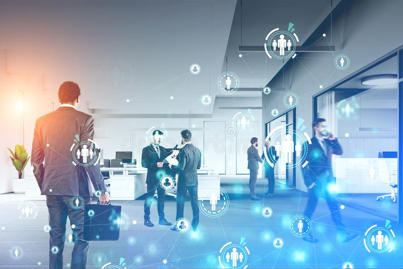 Businessmen in office, social network. Diverse businessmen working in modern office with double exposure of HUD social network interface. Concept of human stock image