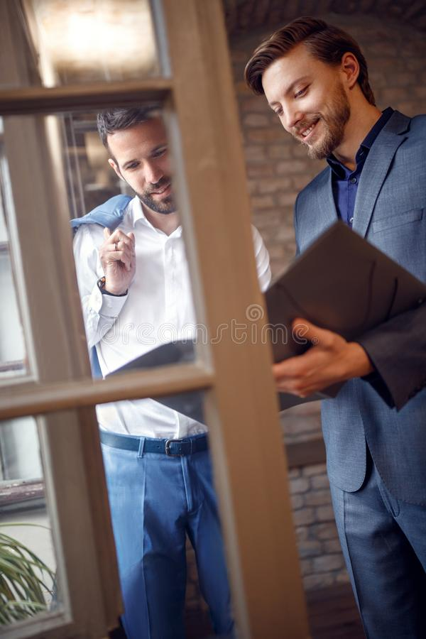 Businessmen in office considering business plan stock images