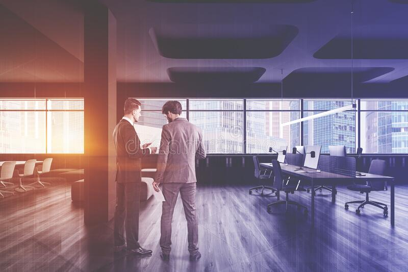 Businessmen in panoramic open space office stock photo