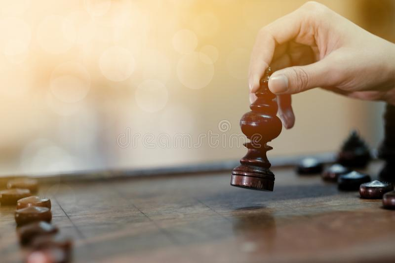 Businessmen playing wood chess board game. Businessman, move, competition, strategy, intelligence, black, challenge, king, power, piece, hand, pawn, leadership royalty free stock image