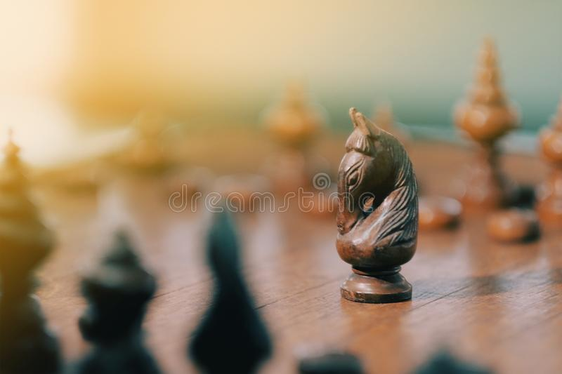 Businessmen playing wood chess board game. Businessman, move, competition, strategy, intelligence, black, challenge, king, power, piece, hand, pawn, leadership stock photo