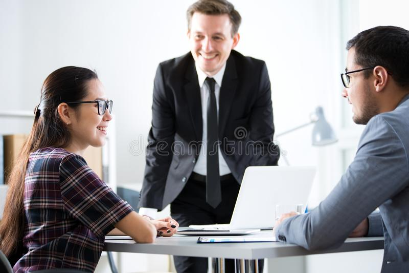Businessmen recruit a young employee. At the office royalty free stock photo