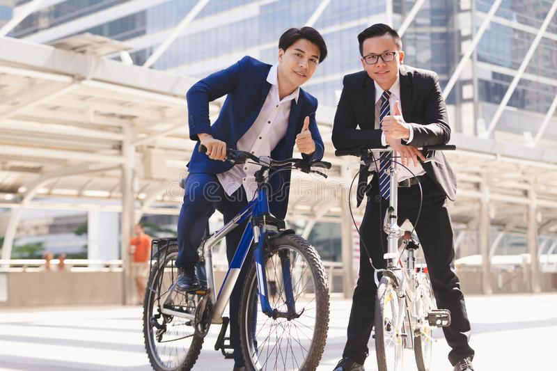 Businessmen riding bicycles stock photo