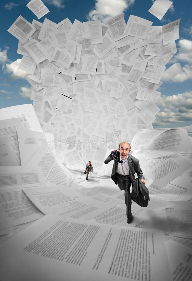 Businessmen running away from wave of documents. Scared businessmen running away from huge wave of documents stock images