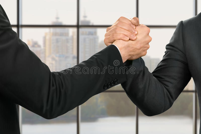 Businessmen's strong and friendly handshake. stock images