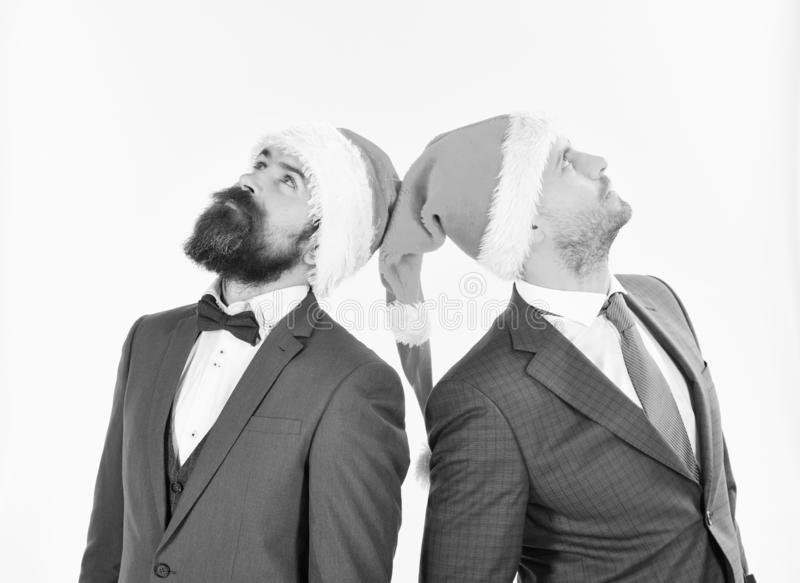 Businessmen with serious faces look up. Colleagues with beards stock images