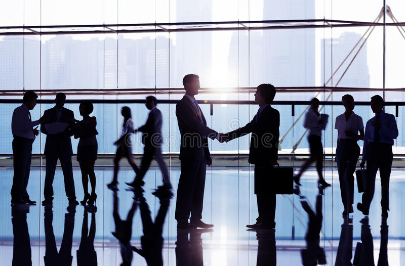 Businessmen Shaking Hand In Office Building royalty free stock images
