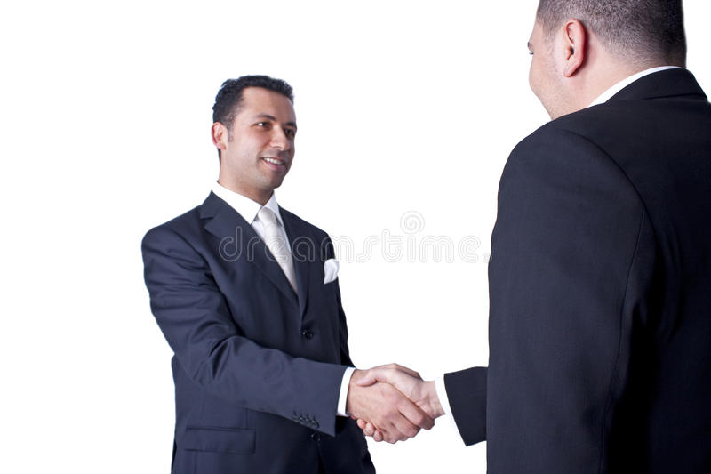 Businessmen shaking hands. Image of two young businesmann handshaking stock images