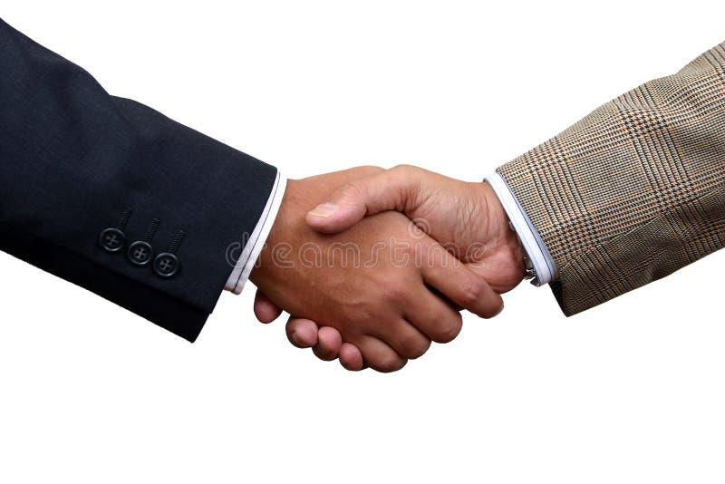 Businessmen shaking hands stock images