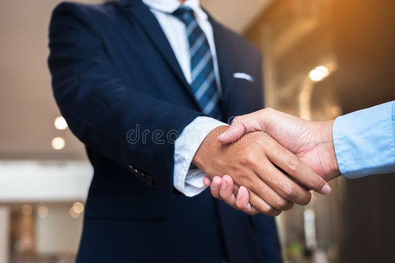 Businessmen shaking hands during a meeting. Handshake deal business corporate royalty free stock images