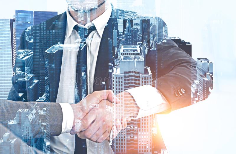 Businessmen shaking hands, morning city royalty free stock photography