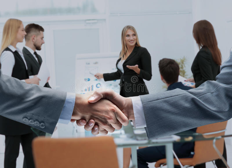 Businessmen shaking hands after signing a lucrative financial co royalty free stock photo