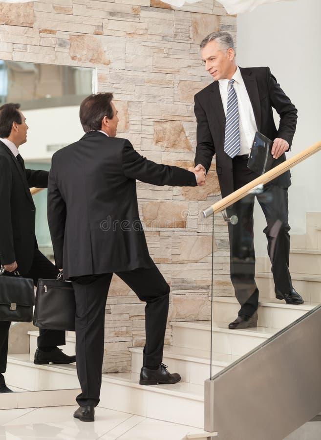 Download Businessmen Shaking Hands On Steps Stock Image - Image: 32352109
