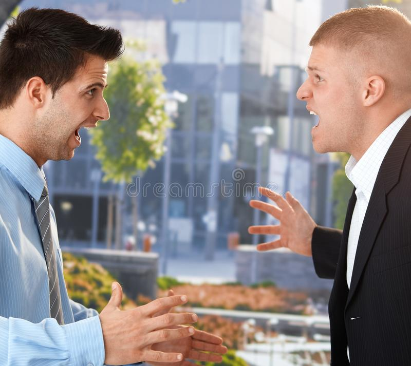 Download Businessmen Shouting In Front Of Office Stock Image - Image: 20531563