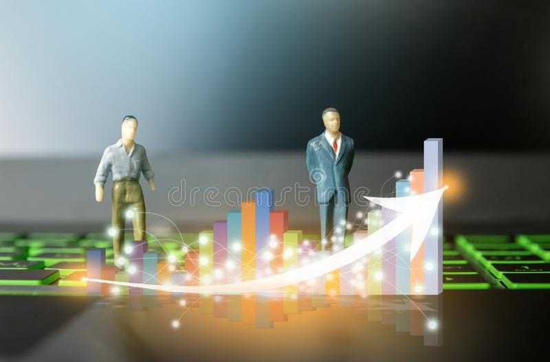 Businessmen small person on computers and leadership bar graph on the computer Investment technology. Finance royalty free stock photography