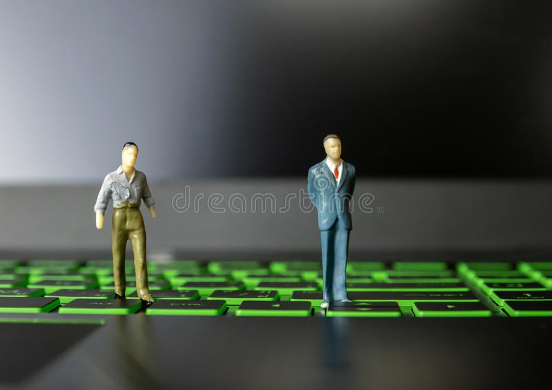 Businessmen small person on computers and leadership. Technology royalty free stock photos