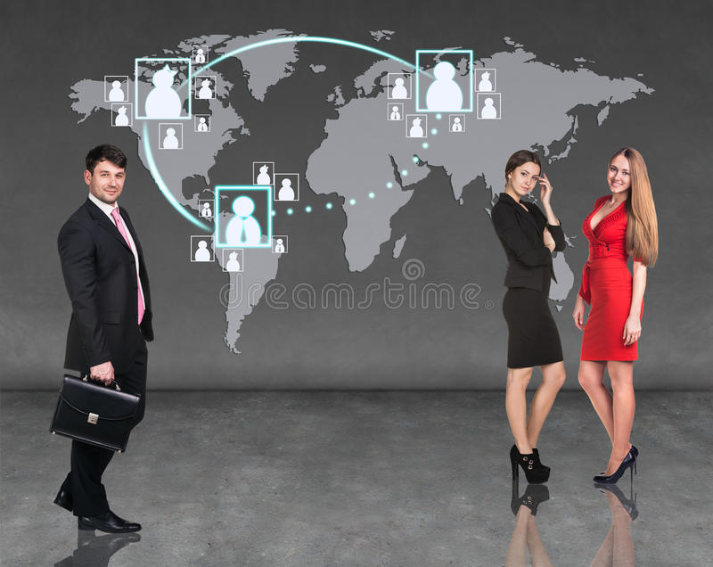 Businessmen standing in front of an earth map. Elements of this image furnished by NASA royalty free stock photo