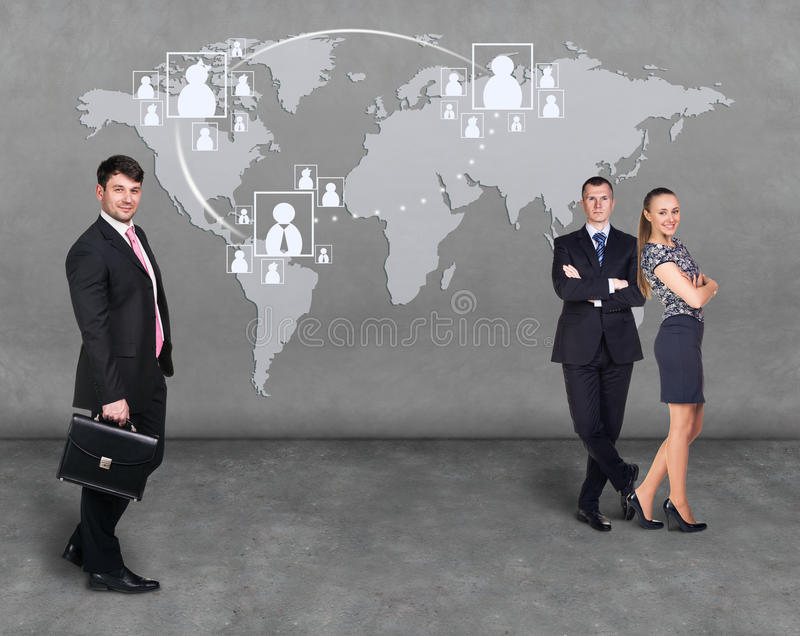 Businessmen standing in front of an earth map. Elements of this image furnished by NASA stock photo