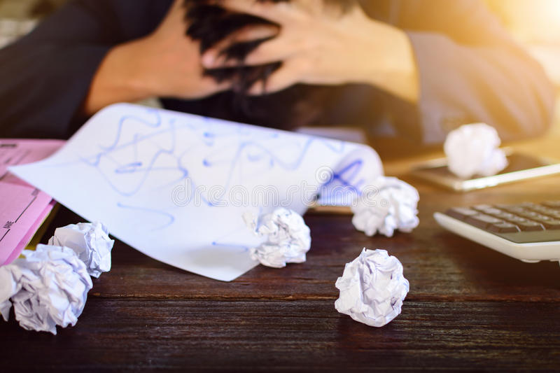 Businessmen stress and Fear Crushed paper on wood table royalty free stock image