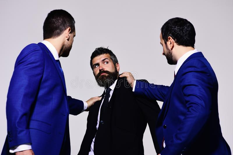 Businessmen with strict and scared faces in formal suits royalty free stock images
