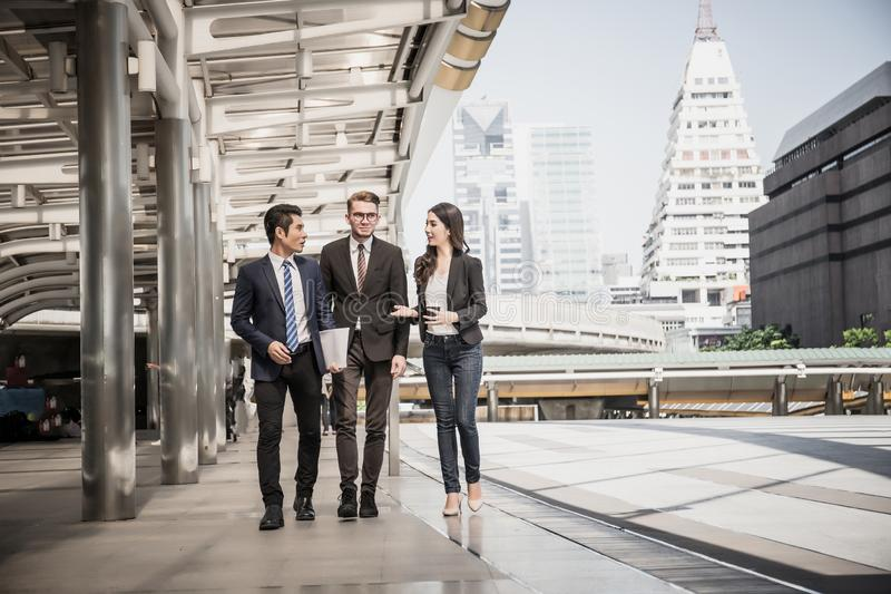 Businessmen talk about work while meeting outside, business partners work royalty free stock image