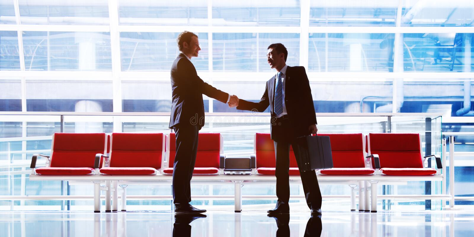 Businessmen Talking Business in the Airport Concept.  royalty free stock photography